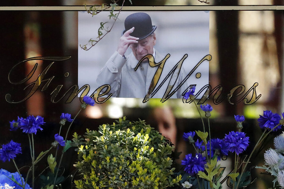 A picture of Britain's Prince Philip is placed in a pub's window in Windsor, England, Thursday, April 15, 2021. Britain's Prince Philip, husband of Queen Elizabeth II, died Friday April 9 aged 99. His funeral service will take place on Saturday at Windsor Castle. (AP Photo/Frank Augstein)