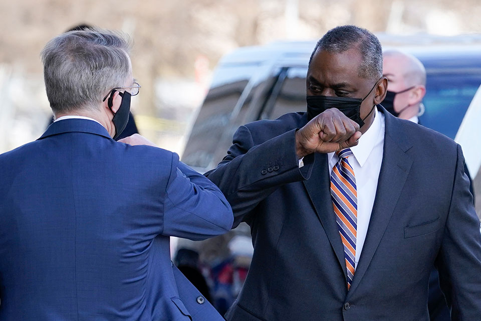 Defense Secretary Lloyd Austin, right, greets Deputy Secretary of Defense David Norquist as he arrives at the Pentagon, Friday, Jan. 22, 2021, in Washington. (AP Photo/Alex Brandon)
