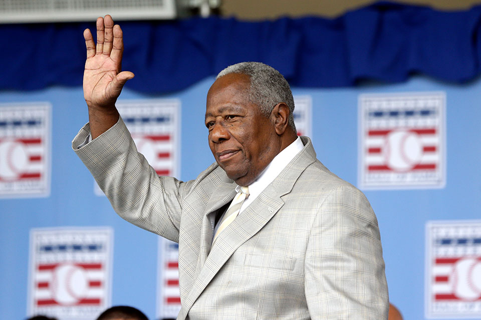 Hall of Famer Hank Aaron waves to the crowd during Baseball Hall of Fame induction ceremonies in Cooperstown, N.Y., in this Sunday, July 28, 2013, file photo. Hank Aaron, who endured racist threats with stoic dignity during his pursuit of Babe Ruth but went on to break the career home run record in the pre-steroids era, died early Friday, Jan. 22, 2021. He was 86. The Atlanta Braves said Aaron died peacefully in his sleep. No cause of death was given. (AP Photo/Mike Groll, File)