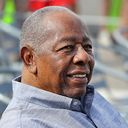 Baseball Hall of Famer Hank Aaron smiles as he is honored with a street named after him outside CoolToday Park, the spring training baseball facility of the Atlanta Braves, in North Port, Fla., in this Tuesday, Feb. 18, 2020, file photo. (Curtis Compton/Atlanta Journal-Constitution via AP, File)