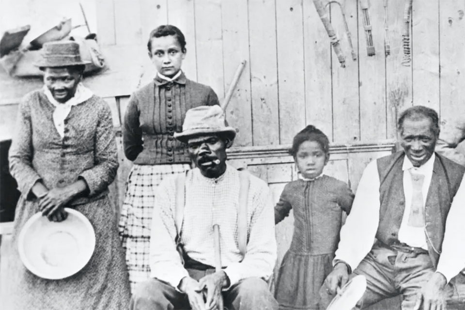 Tubman, left, with a few of the former slaves she helped escape. Bettmann/Getty Images