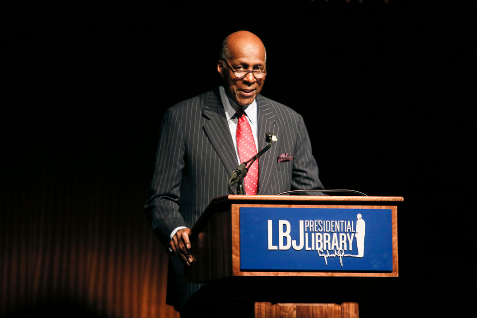In this April 9, 2014 file photo, civil rights activist Vernon Jordan introduces former President Bill Clinton during the Civil Rights Summit in Austin, Texas. Jordan, who rose from humble beginnings in the segregated South to become a champion of civil rights before reinventing himself as a Washington insider and corporate influencer, died Tuesday, March 2, 2021, according to a statement from his daughter. He was 85. (AP Photo/Jack Plunkett, File)