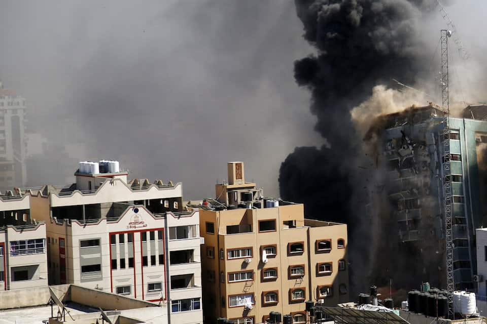 A view of a 11-story building housing AP office and other media in Gaza City is seen moments after Israeli warplanes demolished it, Saturday, May 15, 2021. The airstrike Saturday came roughly an hour after the Israeli military ordered people to evacuate the building. There was no immediate explanation for why the building was targeted. The building housed The Associated Press, Al-Jazeera and a number of offices and apartments. (AP Photo/Hatem Moussa).