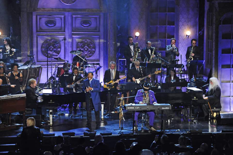 "Elton John, Lloyd Price, Dr. John, and Leon Russell perform at the Rock and Roll Hall of Fame induction ceremony in New York, March 15, 2011. The New Orleans mainstay and Rock and Roll Hall of Famer has died. Price was known for such hits as ""Lawdy Miss Clawdy"" and ""Stagger Lee."" His wife Jackie said he died Monday, May 3, 2021 in New Rochelle, N.Y. (AP Photo/Evan Agostini, File)"