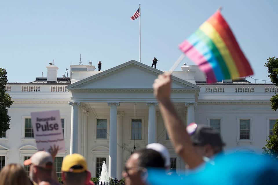 FILE - In this Sunday, June 11, 2017 file photo, Equality March for Unity and Pride participants march past the White House in Washington. The Biden administration says the government will protect gay and transgender people against sex discrimination in health care. That reverses a Trump-era policy that sought to narrow the scope of legal rights in sensitive situations involving medical care. Health and Human Services Secretary Xavier Becerra said Monday that LGBTQ people should have the same access to health care as everyone else. (AP Photo/Carolyn Kaster)