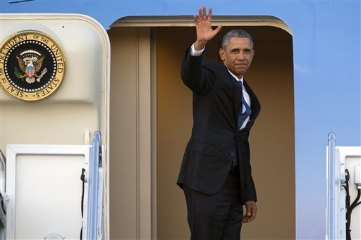Barack Obama waving from AirForce One