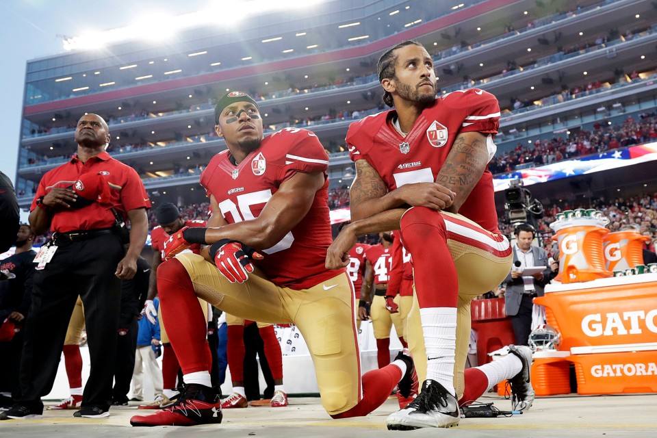 San Francisco 49ers safety Eric Reid (35) and quarterback Colin Kaepernick (7) kneel during the national anthem before an NFL football game against the Los Angeles Rams in Santa Clara, Calif. (AP Photo/Marcio Jose Sanchez, File)