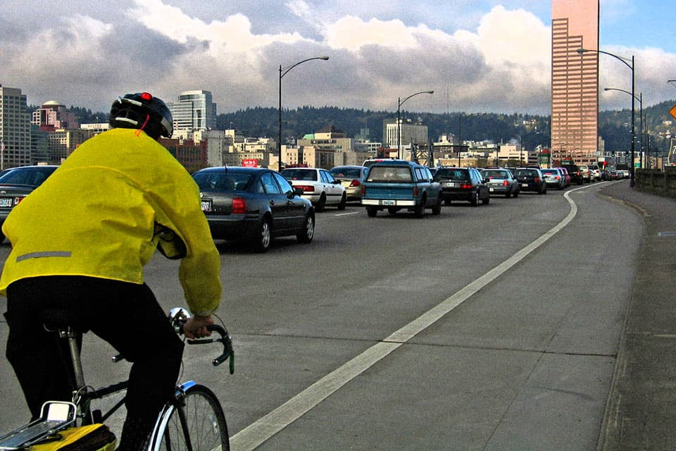 bicyclist on burnside bridge in portland